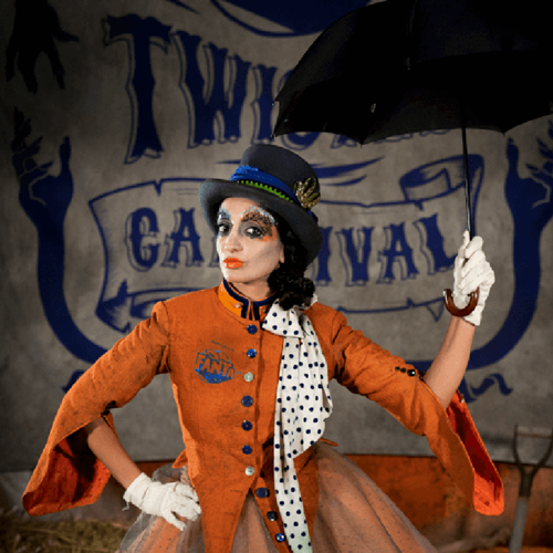Twisted Carnival actor holding an umbrella