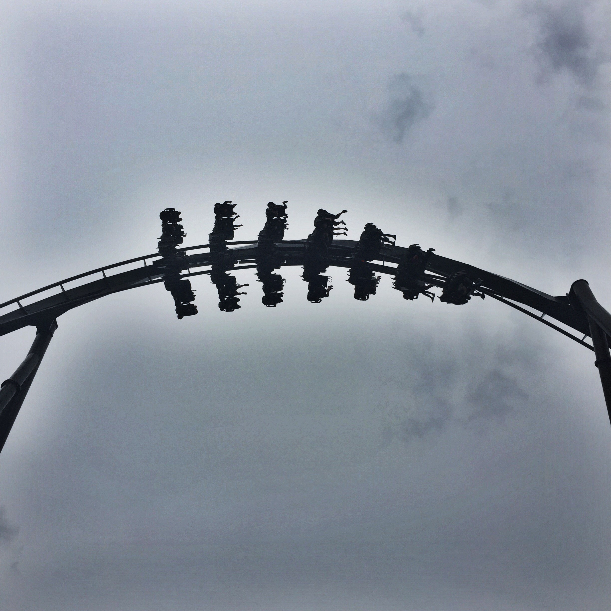 The Swarm Rollercoaster Surrounded By Clouds