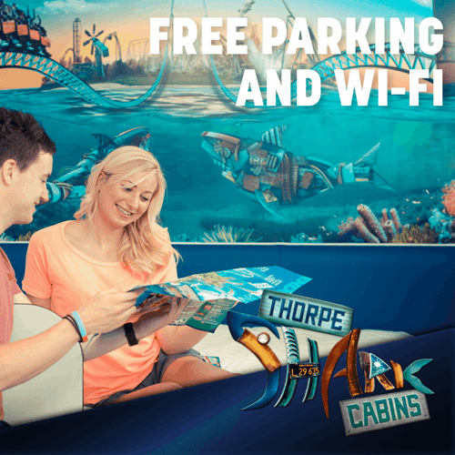 Free Parking And Wifi , Image Of Couple Looking At A Map