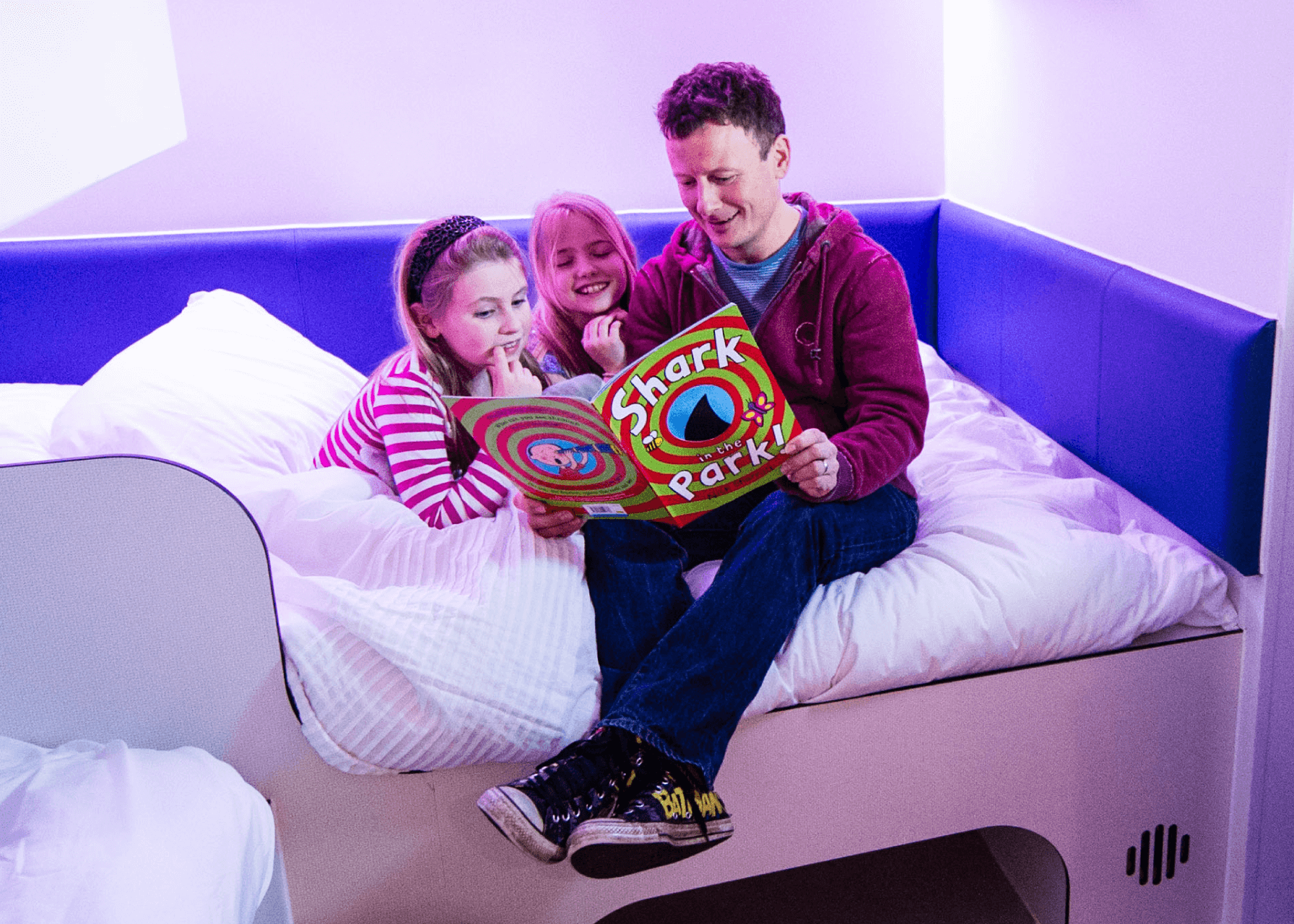 Thorpe Shark Cabins, dad reading a bedtime story to his daughters
