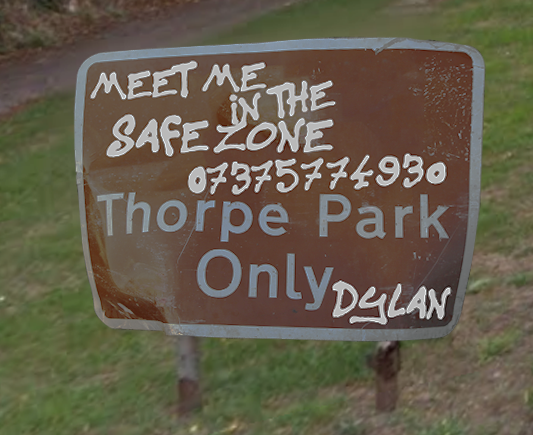 Road sign reading : Meet Me in the safezone 07375774930. Thorpe Park Only. Written by someone called Dylan