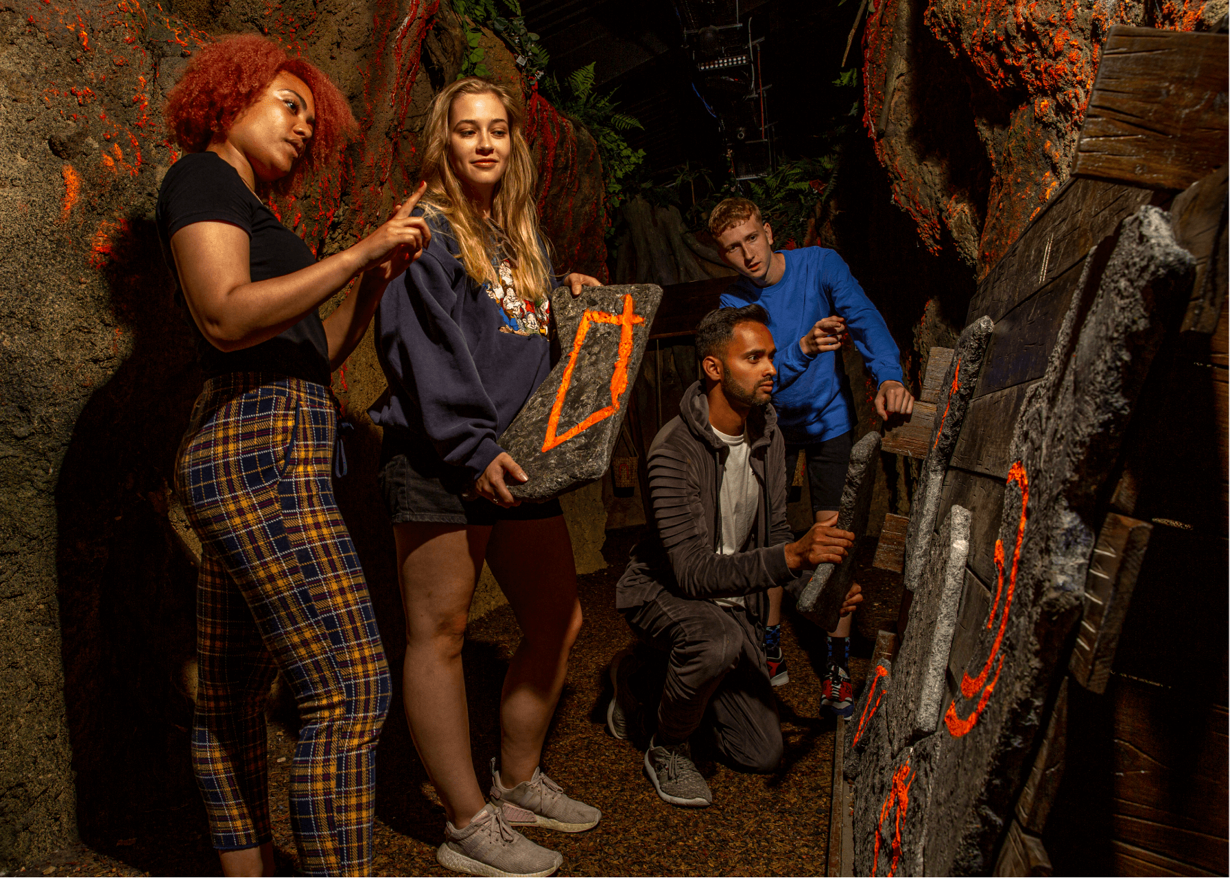 Jungle Escape Puzzle Escape Room, Group solving a puzzle