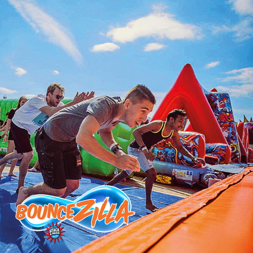 Bouncezilla, guests running towards the obstacle course