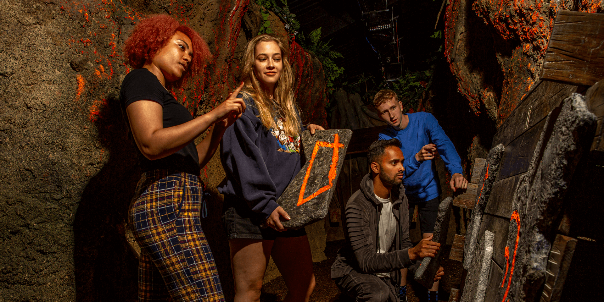 Jungle Escape Room Experience, Guests solving a puzzle